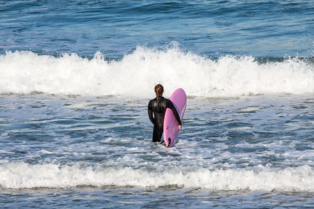 passtime: Surfer on the way to the sea