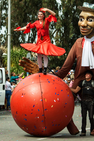 procession: HOLON, ISRAEL - MARCH 16: Unidentified woman walking on the ball through the streets of  Holon during a procession on the feast of Purim carnivall March 16, 2014 in Holon, Israel.