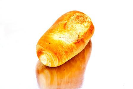 breadbasket: fresh baked rolls in a basket on  mirror surface
