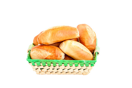 breadbasket: fresh baked rolls in a basket isolated on white