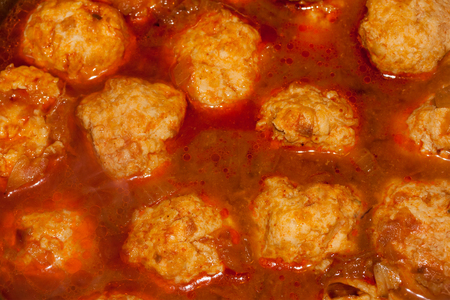 meatballs with tomato sauce in black pan Stock Photo - 66256389