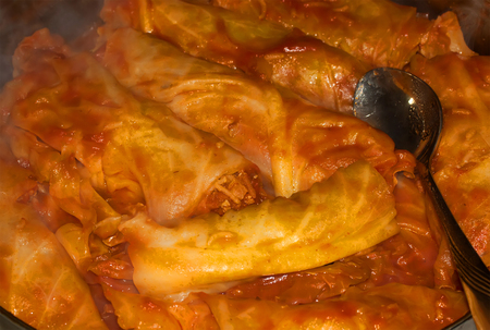 Stuffed cabbage rolls with rice and mushrooms in tomato sauce