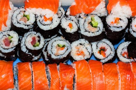 homemade sushi with wild salmon, shrimp, cucumber and seaweed Stock Photo