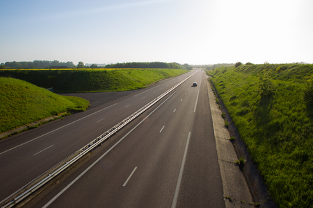 Highway in Normandy . Springtime Sunset . Travel in France