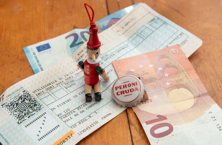 Memories of a 6 day trip in Italy - during the Christmas holidays: Pinocchio, tickets for an Italian train, a beer bottle cap .. and European money  - sweet , sweet  Italy