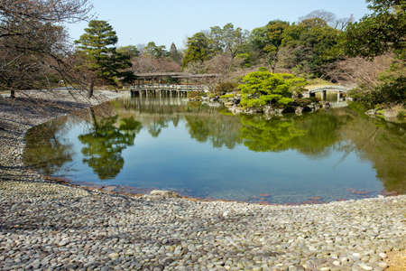 Excursion to the Garden at the Imperial Palace in Kyoto. Pond and stones on the shore 40,000 pieces of the same size