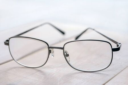 typical glasses on a white background in a metal frame  ( Ophthalmologist Prescription Glasses)