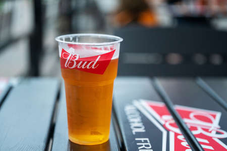 07/18/2020. Krasnogorsk, Russia. Light beer Budweiser (Bud) in Russian cafe in plastic glass - in Moscow oblast - suburb - Krasnogorsk