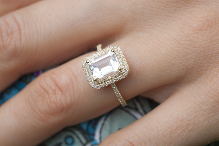 gold ring: engagement ring on womans hand