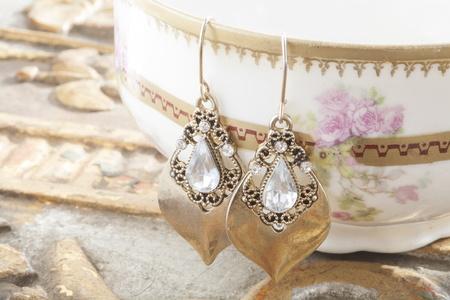 silver plated: Beautiful shiny earrings on the vintage background Stock Photo