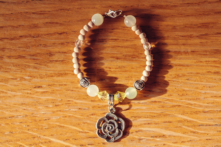 soft sell: Bracelet with rose pendant and jadeite mineral gem stone Stock Photo