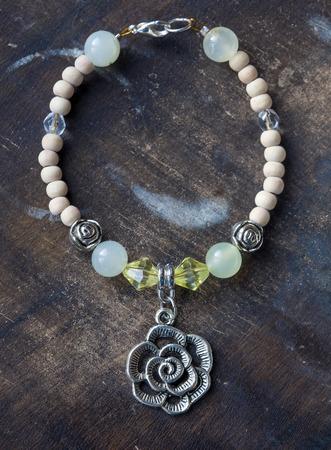 yogini: Bracelet with rose pendant and jadeite mineral gem stone Stock Photo