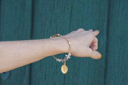 czech republic coin: Hippie hand with a bracelet