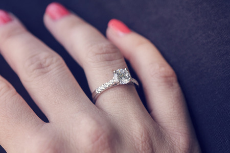 Woman's hand wearing an engagement ring