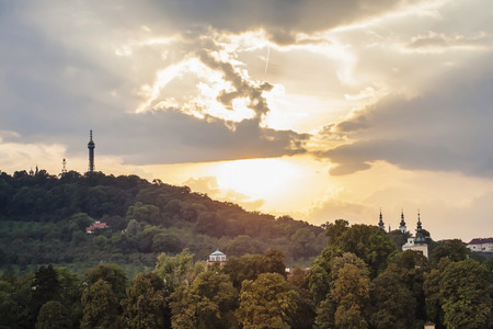 View on Petrin hill with Petrin lookout tower with beautiful sunset sky