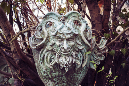 woodland sculpture: Satyr Woodland god face sculpture