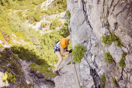 via: Woman climbing via ferrata in Austria Stock Photo