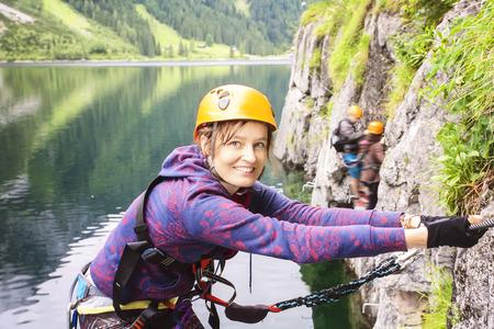 Woman climbing via ferrata, Gosausee, Austria