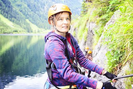 via: Woman climbing via ferrata, Gosausee, Austria