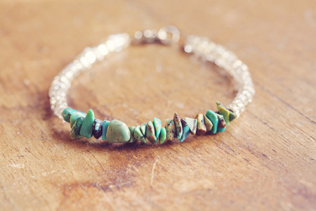 mineral stone: Mineral stone bracelet on the table Stock Photo
