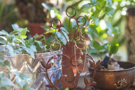 bijoux: Beautiful earring on hippie background Stock Photo