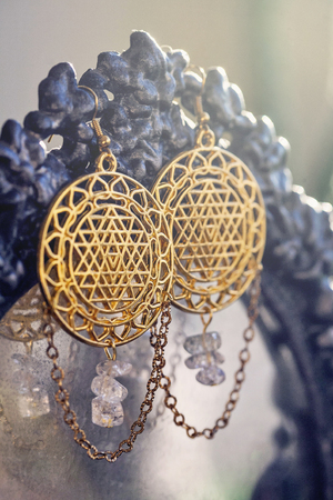 Esoteric earrings with sacred geometry Stock Photo