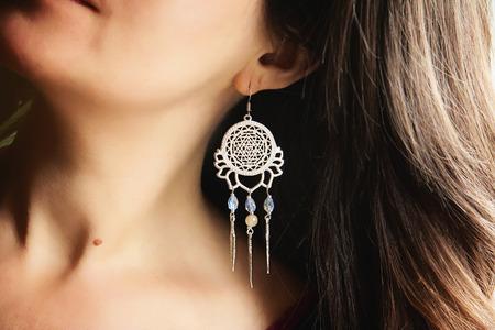 Beautiful lady detail wearing romantic earring