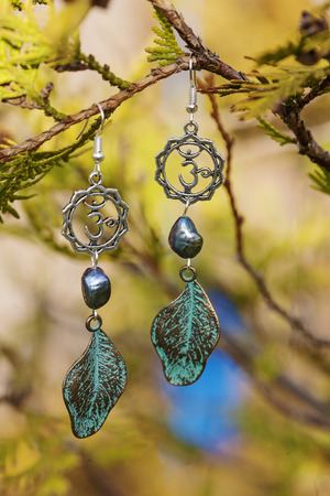 Earrings with burdock leaves and river black pearls