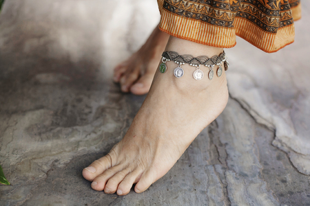 Female ankle with gypsy bracelet