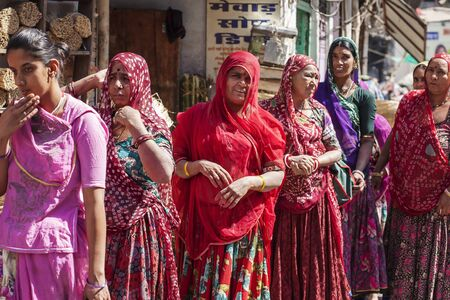 Udaipur city, Rajasthan, India, February 9, 2018: Indian women traditionally dressed shopping at vegetable market