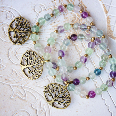 Three natural Fluorite stone beads bracelets with tree pendant Stock Photo