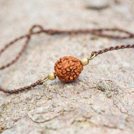 Elegant tiny bracelet on natural wooden background