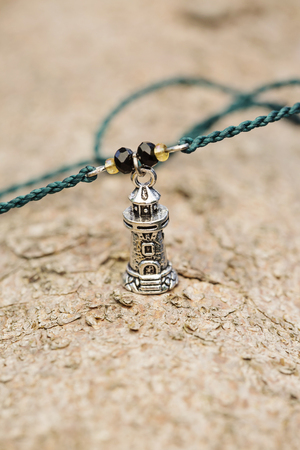 Tiny fashionable jewelry in the shape of lighthouse
