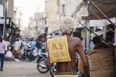 Udaipur, Rajasthan, India, January 31, 2018: Skinny Indian man walking on the street