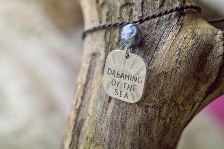 Natural fashionable Bracelet on wooden background