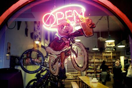 Fairfax in Marin County, California, USA, January 5, 2012: Bike bar pub window with open sign