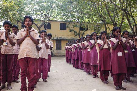 Arunachala, Tiruvannamalai, Tamil Nadu in India, January 30, 2018: Indian Public school, children in school uniforms greeting new day Editorial