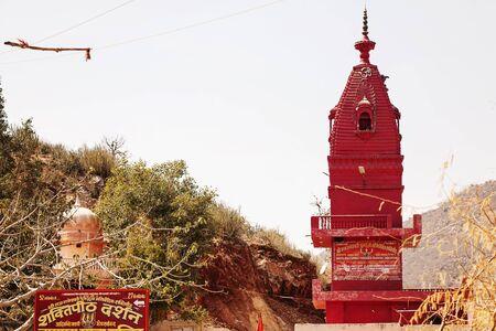 Pushkar, Rajasthan, India, February 2018: Red Shiva temple obove the Pushkar city