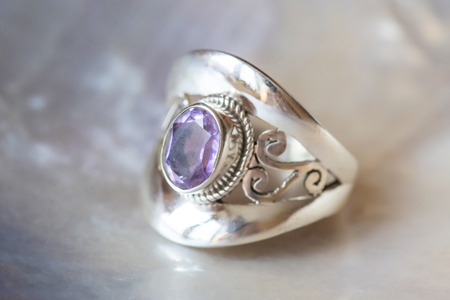 Beautiful silver ring with cut amethyst gemstone