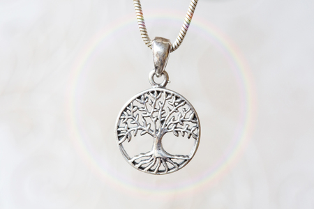 Silver tree pendant on natural white background