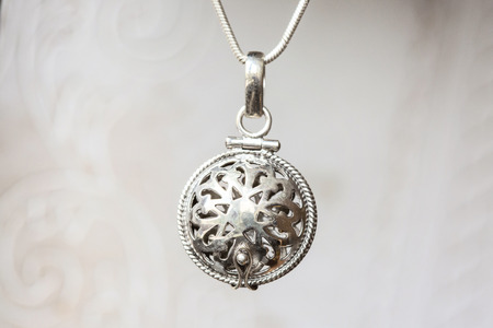 Silver pendant on natural white background