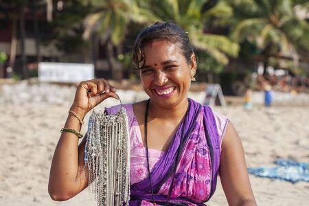 Gokarna in India, January 15, 2018: Indian woman jewelry seller portrait at Kudli beach resort in Gokarna city Editorial