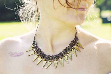 Woman outdoor wearing macrame necklace Stock fotó