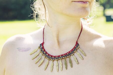 Woman outdoor wearing macrame necklace Stock fotó - 130316917