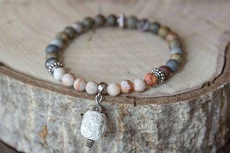 Natural mineral stone bracelet on wooden background