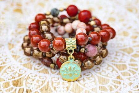 Lotus pendant mineral stone boho mala necklace on decorative background Stock fotó
