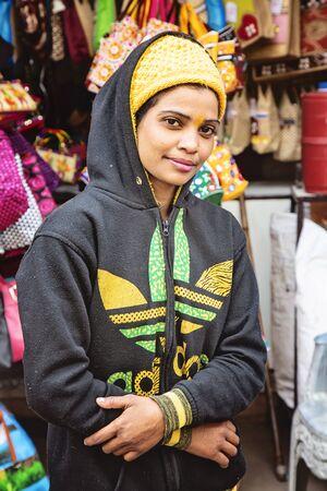 Pushkar, Rajasthan in India, February 13, 2019: young Indian girl in Adidas hoodie visiting holy lake in Pushkar Sajtókép