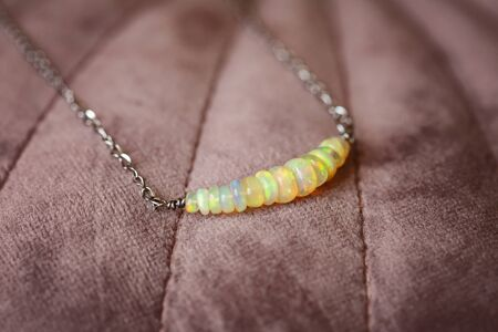 Natural opal gemstone necklace on pink velvet Stock fotó - 132141528