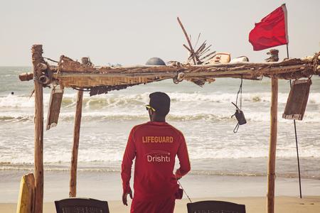 Arambol, Goa in India, February 9, 2019: Lifeguard watching the sea at Arambol beach
