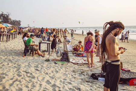 Arambol, Goa, India, February 1, 2019: Souvenir sellers on Arambol beach at the sunset